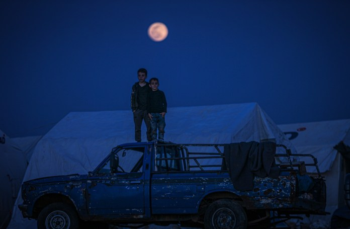 Children in Syria climbed onto a pick-up truck to see the skies