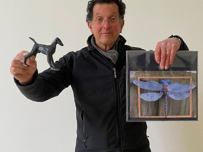 Competition judge Sir Antony Gormley with a picture of winner Suzan Inceer's work