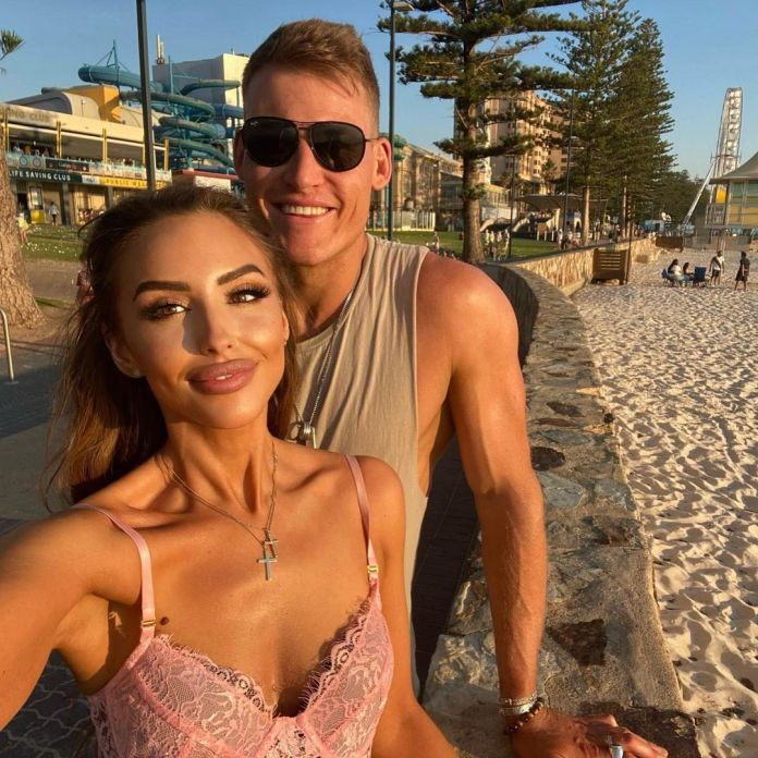 The brunette beauty hinted that she's back together with second 'hubby' Seb Guilhaus