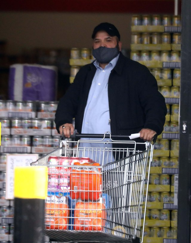 We pictured Rauf in Rochdale stocking up on food and fizzy drinks at a store
