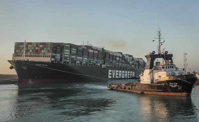 The Panama-flagged cargo ship is pulled by one of the Suez Canal tugboats