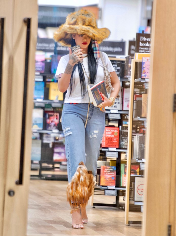 Rihanna turns heads with a giant £2,000 fur hat as she shops for books in LA