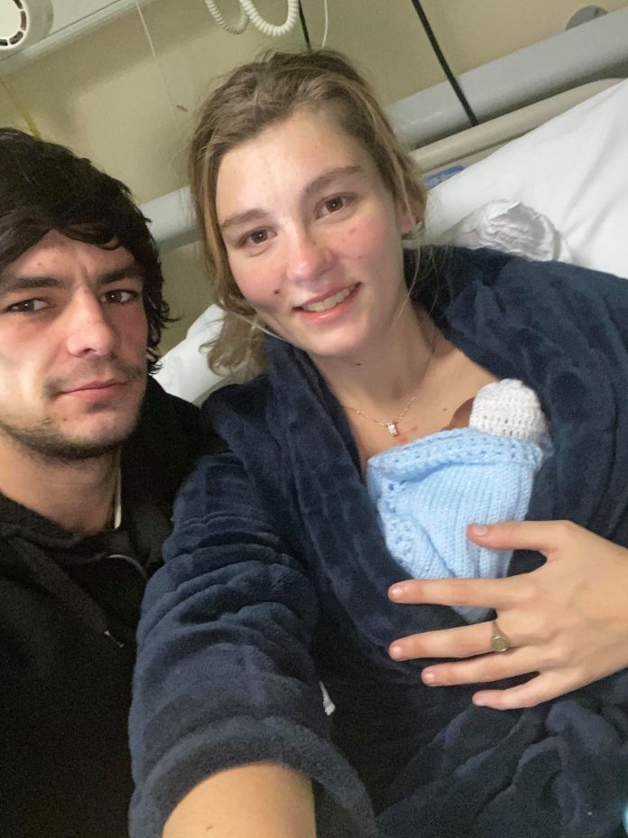 Bethany Lamming with partner Marcus Ford and baby Jensen in hospital