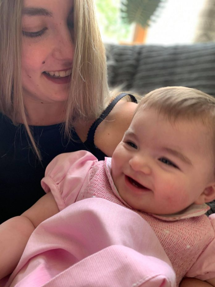 The 21-year-old with her daughter Evie