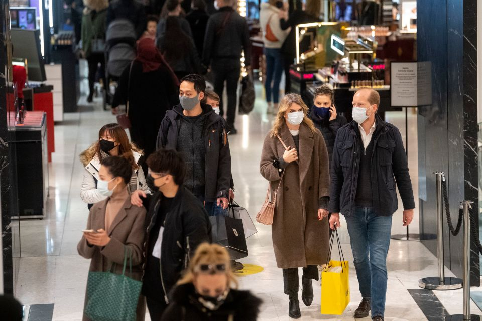 Shop 'till you drop! Customers are seen walking through Selfridges in London today