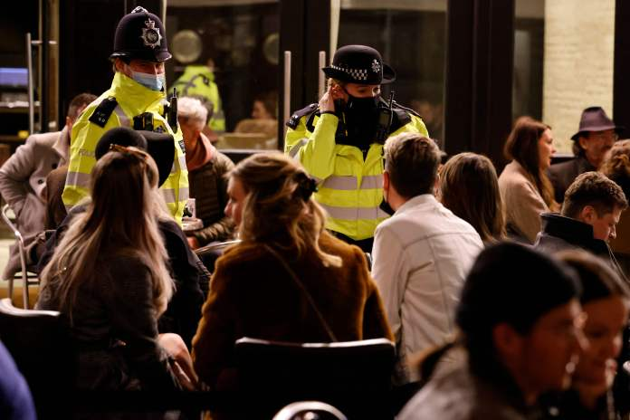 Police on scene try to ensure social distancing rules are maintained