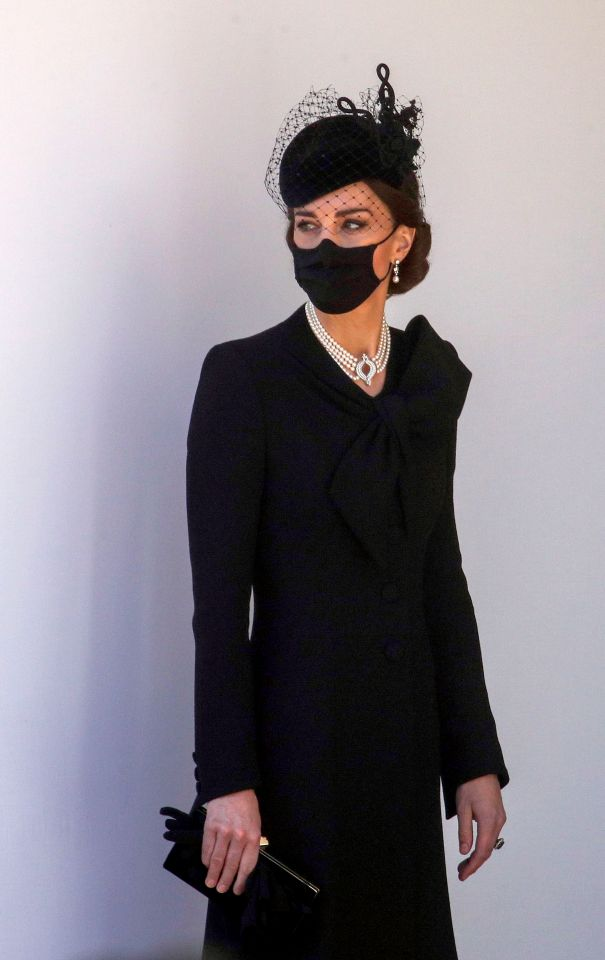 Kate Middleton wore a pearl necklace and black face mask