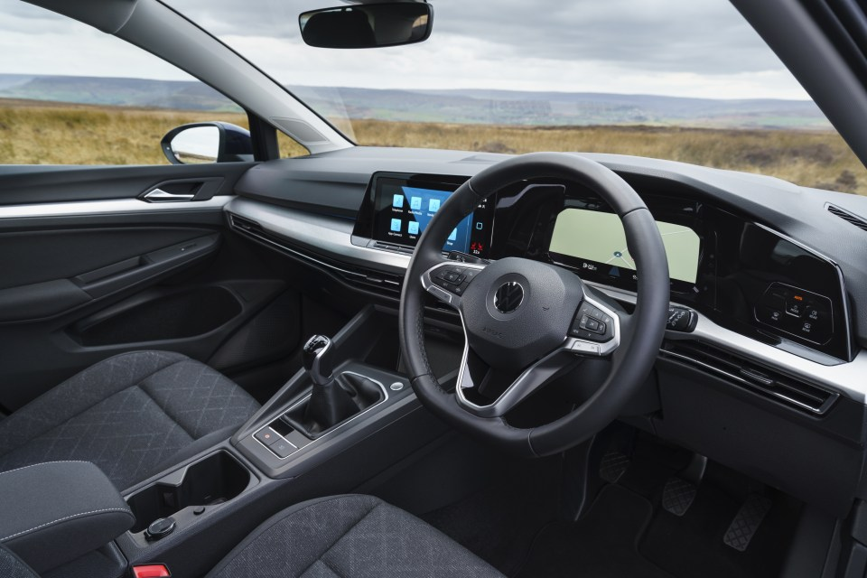This base version of Golf  has actual switches on the steering wheel