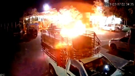 CCTV shows flames quickly engulfing the truck parked near a petrol station in Thailand