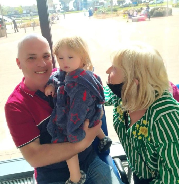 Jaydon was suspected to have a virus and was sent home to recover, where he lives with grandparents Arwel and Christine (pictured) and mum Tiffany