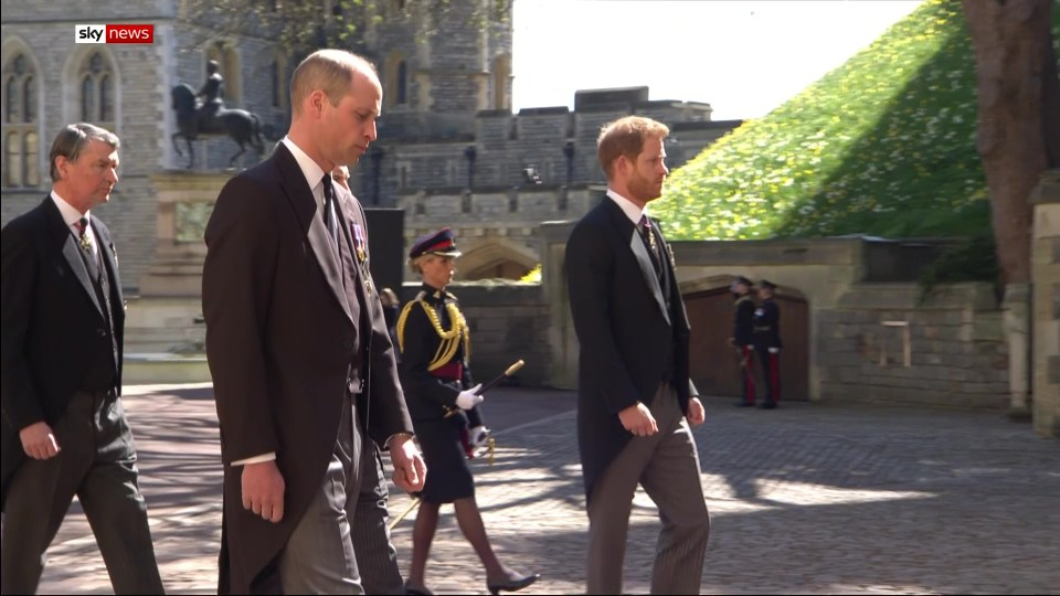 Harry stood apart from William as they walked to Philip's funeral