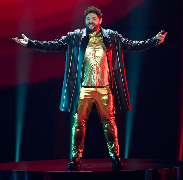UK entry James Newman in his shiny gold trousers in rehearsal - but he has now decided to ditch them in favour of something more fireproof due to on-stage pyrotechnics
