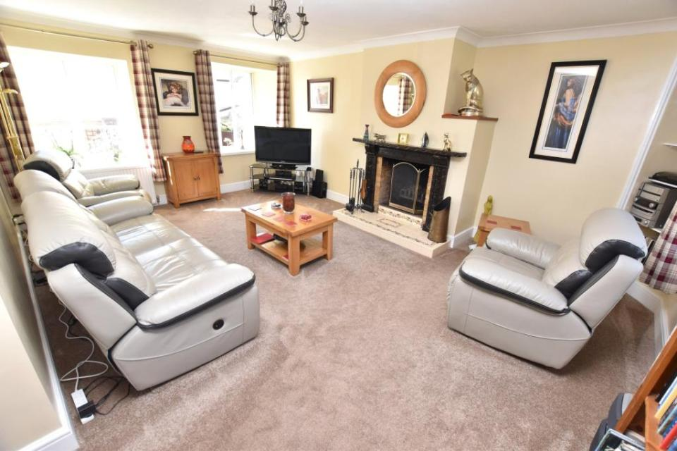 It features a spacious, modern living room
