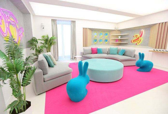 The small-use lounge had two spacious rabbit chairs and a sofa
