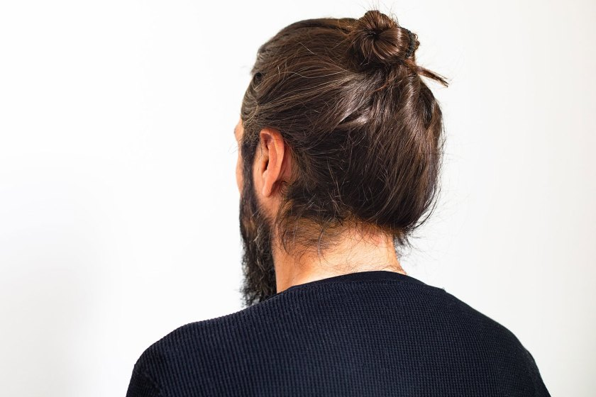 Wearing a hat and styling your hair in a man bun does not cause hair loss