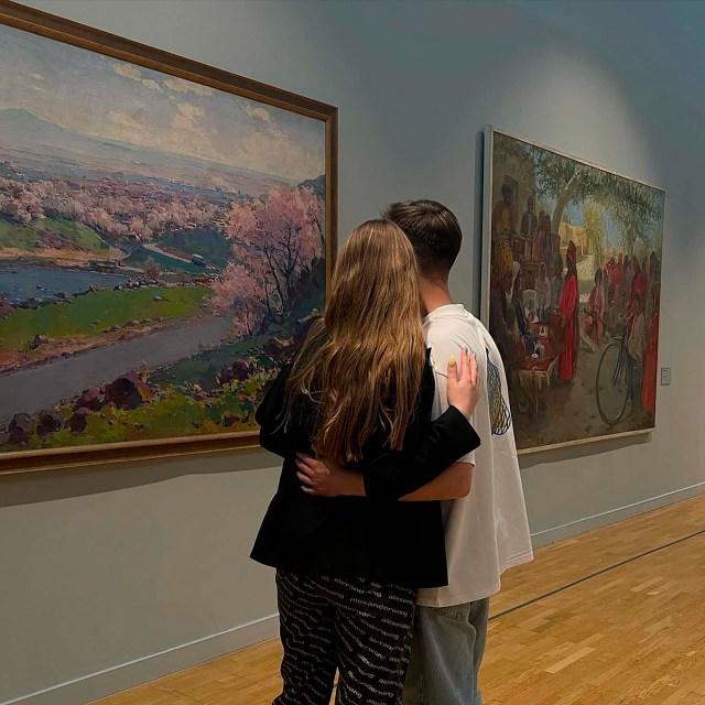 Luiza Rozova pictured with her boyfriend in an art gallery