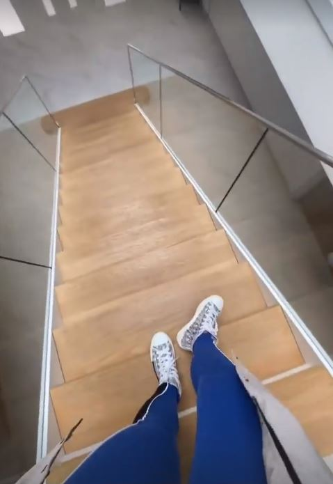 Stairs made of wood with glass railings
