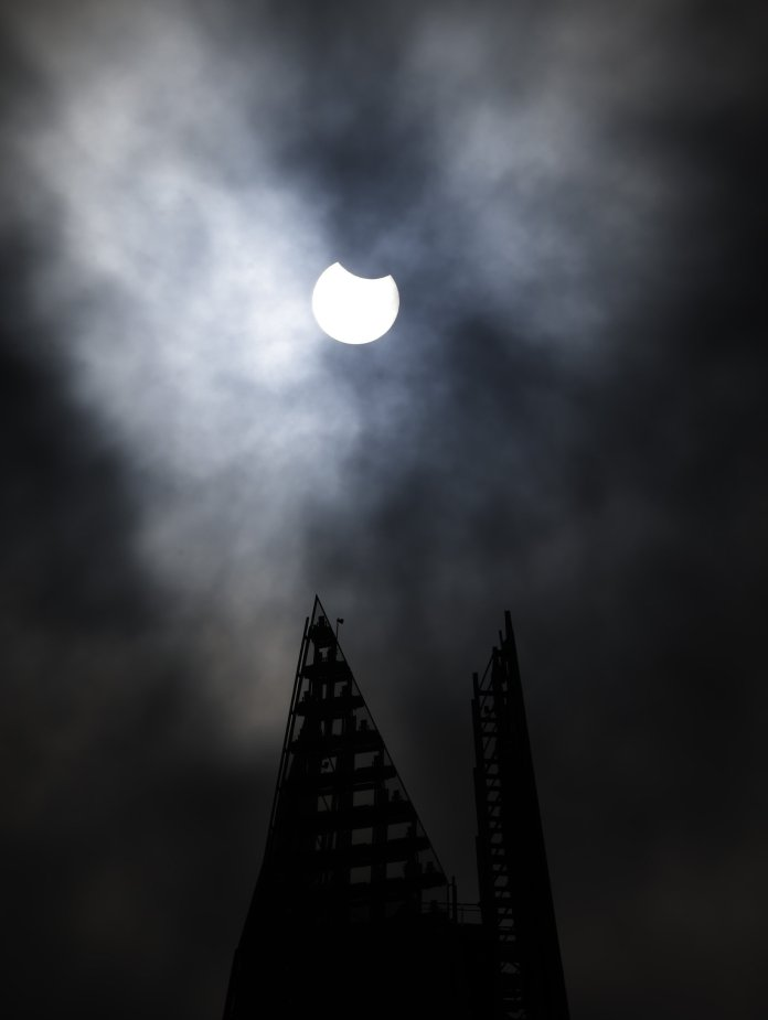 Partial eclipse starting over The Shard in London