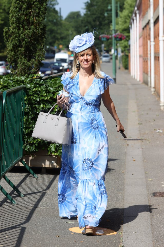 Ascot attracts many well-heeled racing fans, including this woman who was a vision in blue