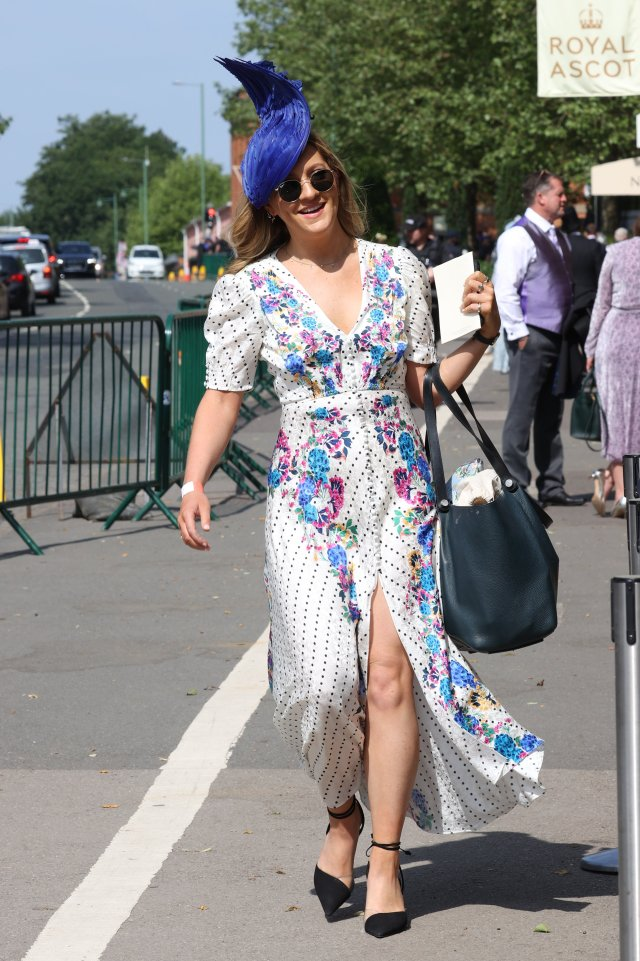 This stylish Ascot attendee donned a stunning blue hat to match her floral gown