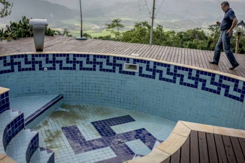 The swastika in Wandercy Pugliesi's swimming pool was spotted by cops in Brazil
