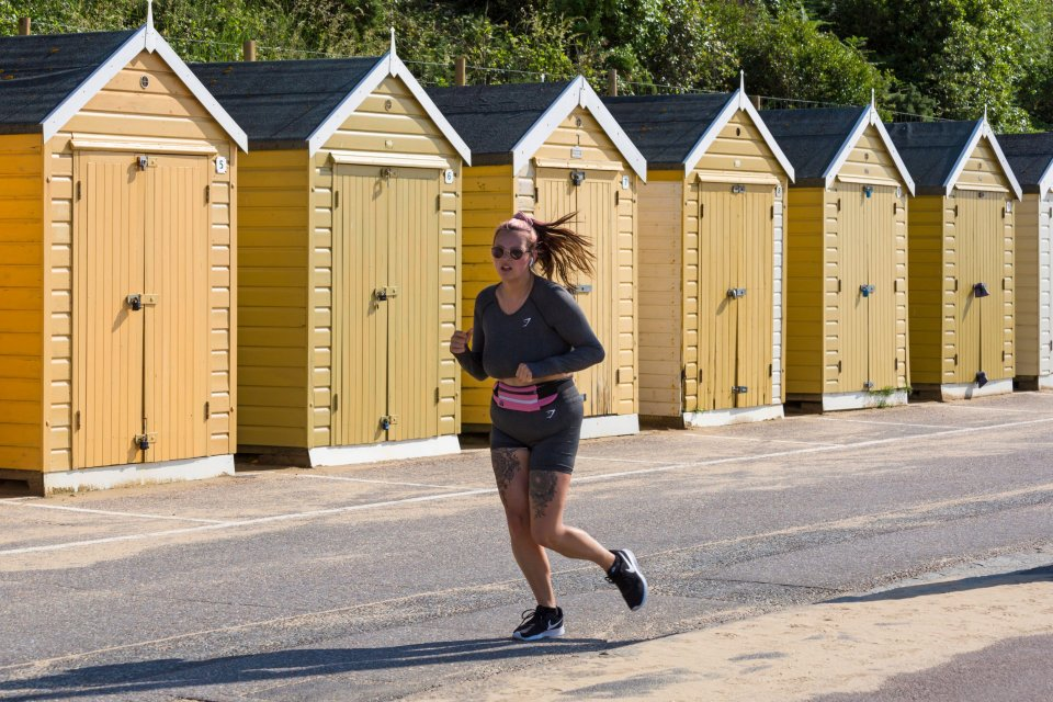 A jogger enjoys the sun in Bournemouth