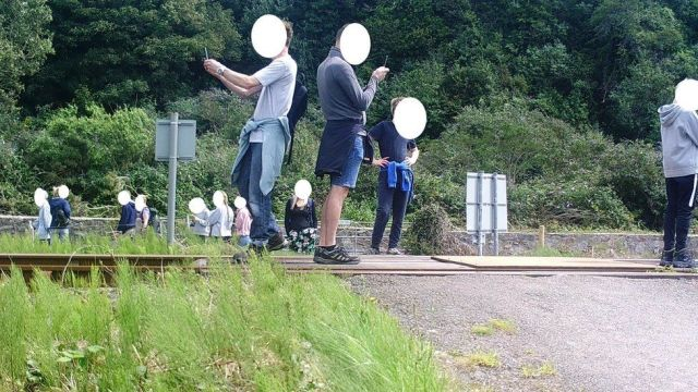 BTP warned against the danger of posing for pictures at a level crossing