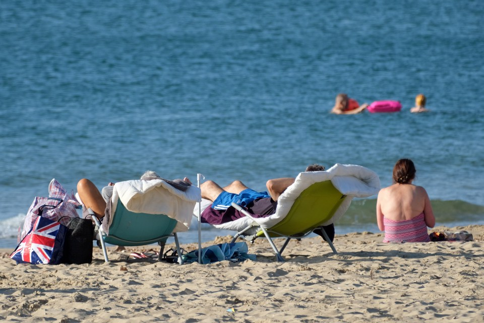 And by 7am, sun-worshippers were already taking a dip in Bournemouth, Dorset