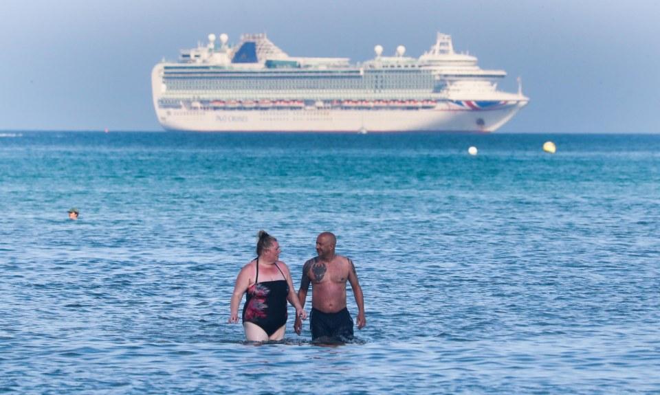 People take a swim as the mercury soars in Weymouth