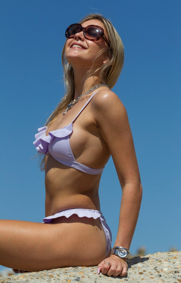 Summer Wallace, 21, soaks up the rays in Brighton