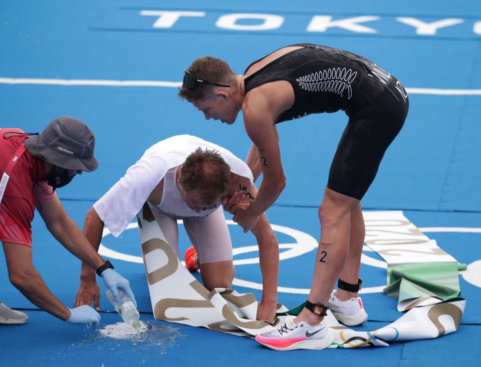 Blummenfelt was helped to his feet by his rivals at the finish line