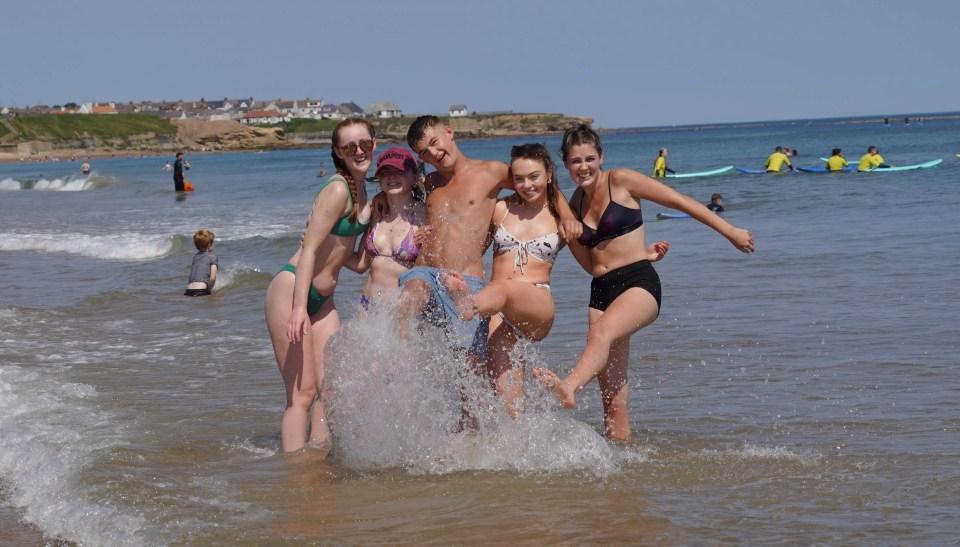 Friends cool off Tynemouth Longsands beach