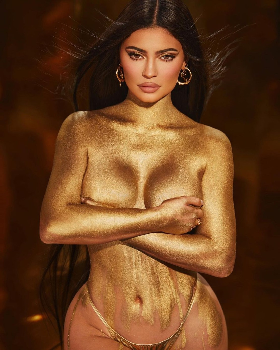 Kylie Jenner leaves little to the imagination as she poses nude in gold paint
