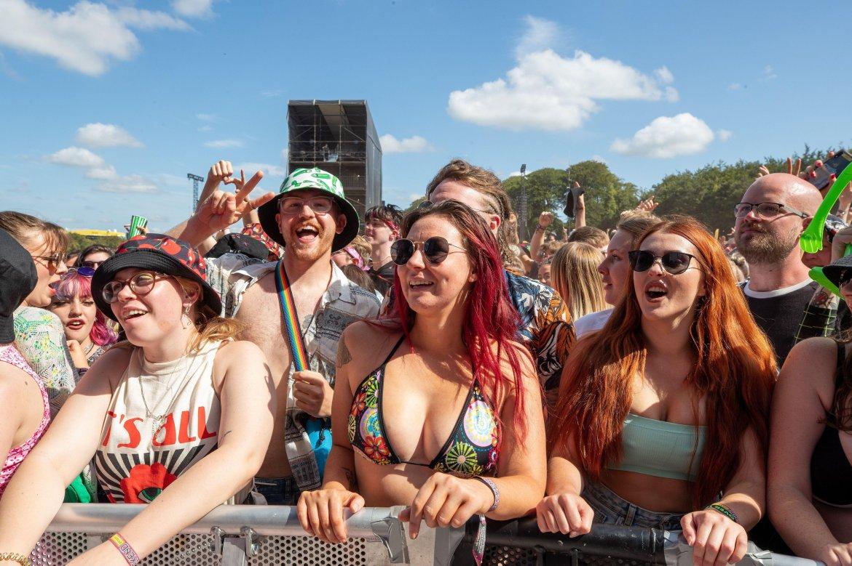 Bikini-clad revellers are seen enjoying the music