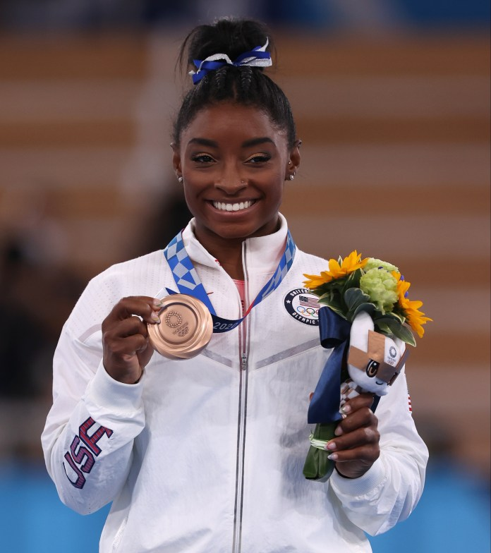 Biles won bronze in balance beam but withdrew from her other events