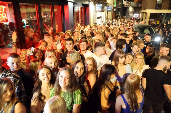 Huge groups of students try to go to the bar and club in Newcastle city center