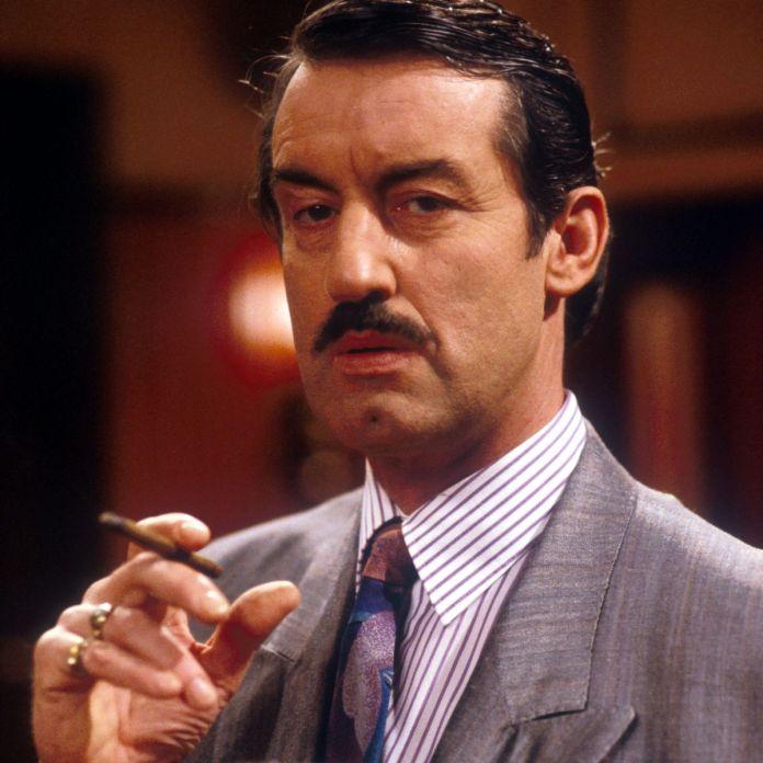 John as cigar-chomping car dealer Boysy in Only Fools and Horses