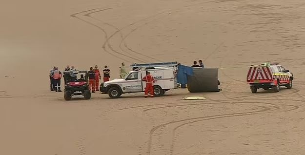 Paramedics attempted to revive the man on the sand
