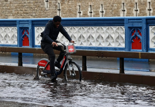 A cyclist struggled in the torrential rain