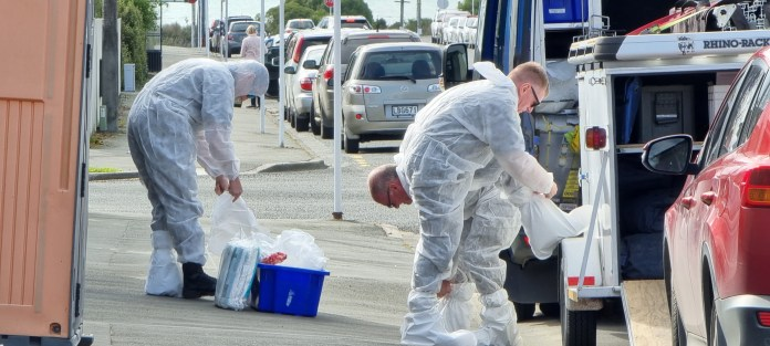 Police forensic officers at the scene in Timaru, New Zealand