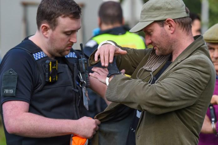 a handcuffed protestor