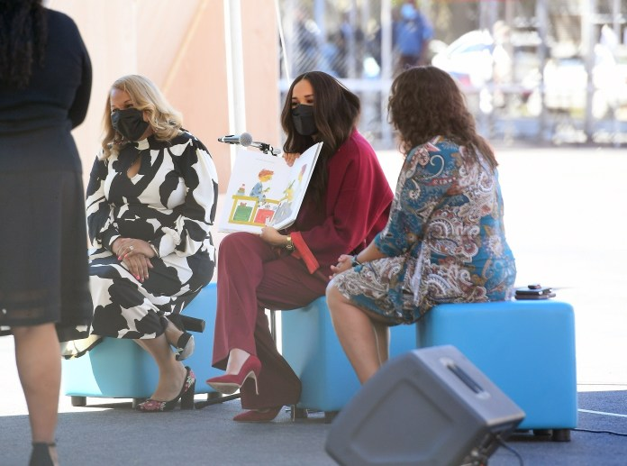 The Duchess shows off the illustrations from The Bench