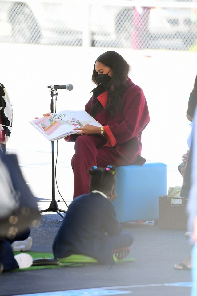 Schoolkids watch on as Meghan reads her book