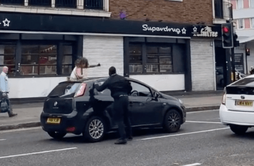 The driver got out of the car and punched the woman in the leg