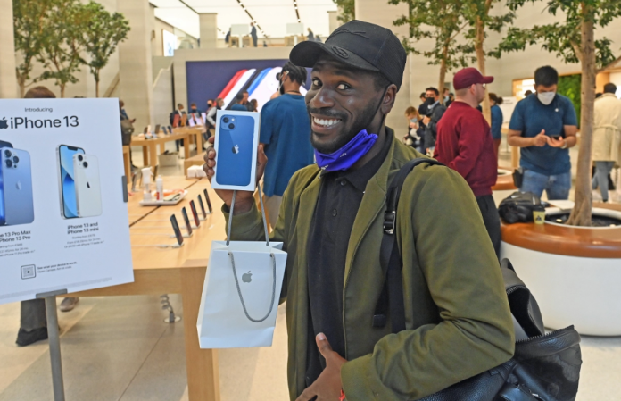 Kwame, 33, acquired the iPhone 13 after just three minutes of queue outside Apple's flagship store in London