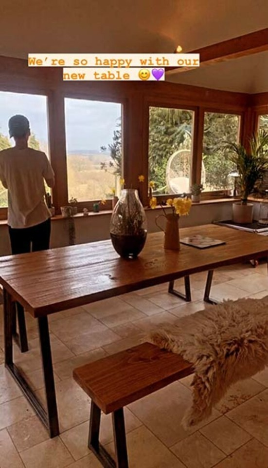 The dining room features a Scandinavian-style dining table