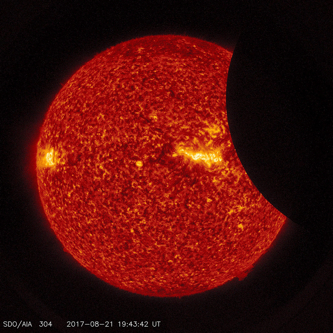Image of the Moon transiting across the Sun, using a blend of 171 ångstrom extreme ultraviolet light and visible light imagery from SDO from August 21, 2017. Credit: NASA/SDO