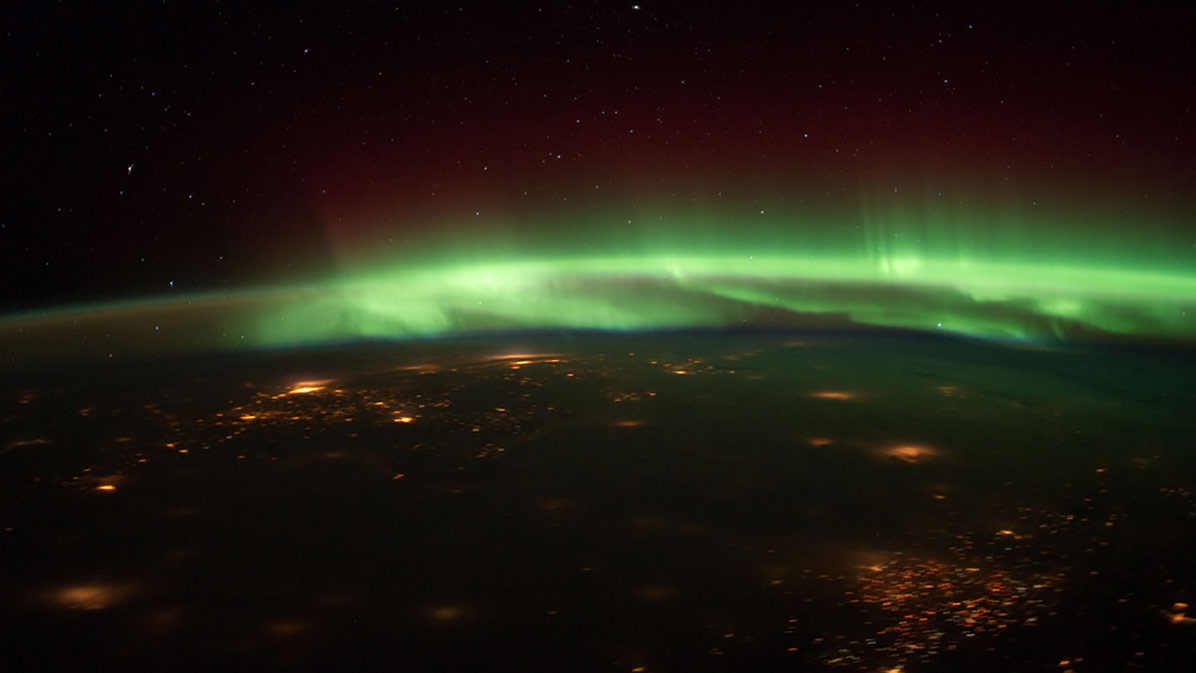 An astronaut aboard the International Space Station captured this photo of auroras glowing above the Midwest on Jan. 25, 2012.