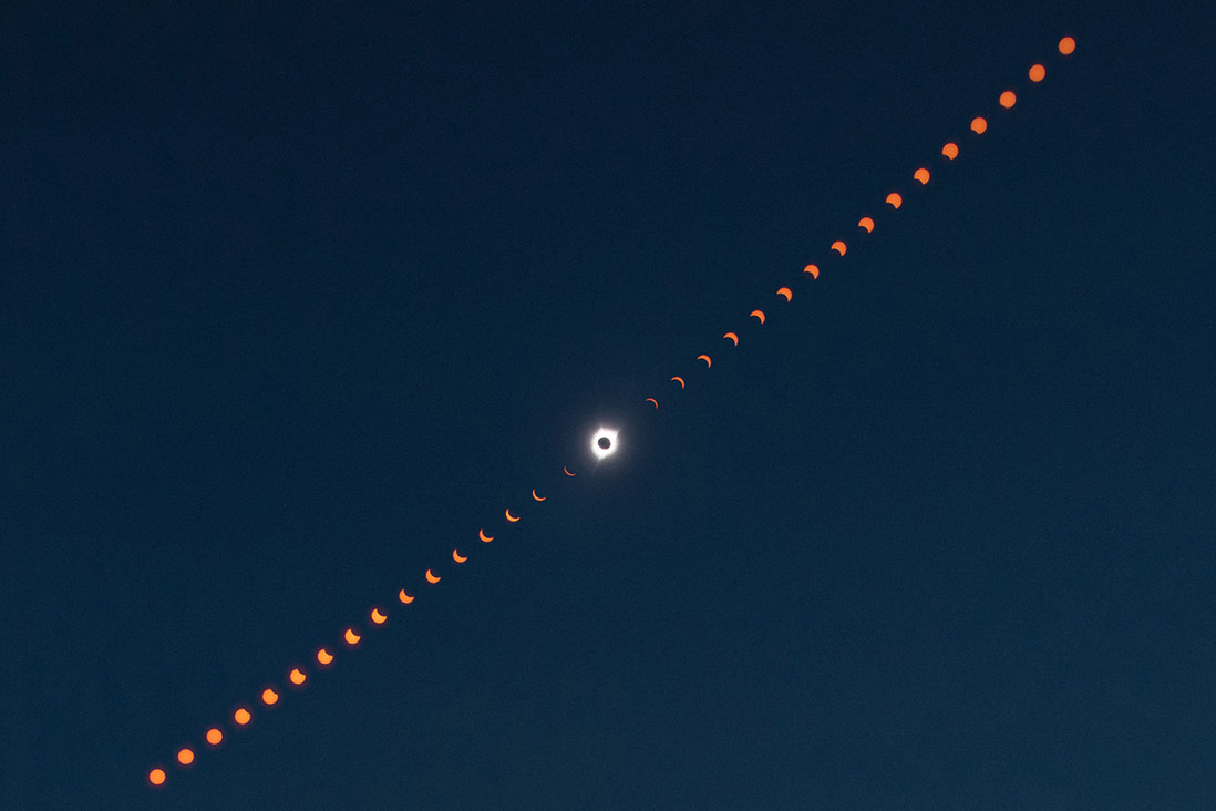 This image is a composite photograph that shows the progression of the total solar eclipse over Madras, Oregon.