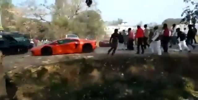 Lamborghini, Ferrari stoned by angry mod in India